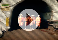 A number of Vale miners emerging from a mine in their full safety attire