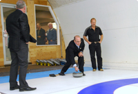 Vale executives christening Kronau's new curling rink.