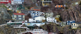 Colorful houses on the side of a hill in the St.John's harbour