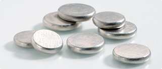 Eight, silver discs are all piled up together on a white background