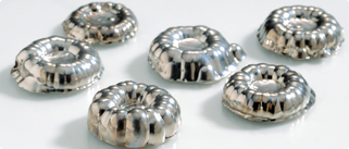 six, silver, electrolytic nickel r-rounds all sit together on a white background