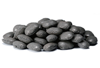 Tonimet in the shape of small, round, grey pebbles, piled up together