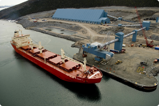 A large, red shipping boat in Voisey's Bay Harbour