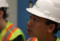 A Vale employee wearing a hard hat and safety gear