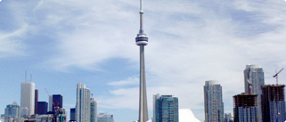 The Toronto City Skyline featuring the CN Tower and other grey buildings