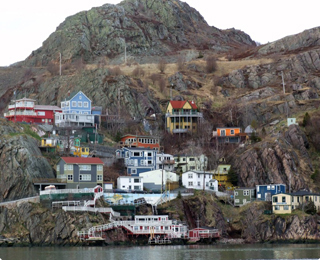 Colourful houses located on the side of a hill in the St.John's harbour