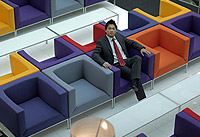 A Vale employee sits in a purple chair, among rows of other colourful armchairs
