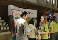 Vale employees and job seekers in front of a Vale booth at a job fair