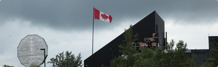 A Canadian flag and the Sudbury Big Nickel outside of the Sudbury operation