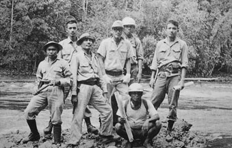 Beni Wahju (far right) stands on the brink of Larona River with Inco Ltd exploration team in 1966